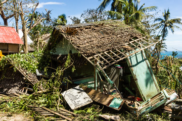A wooden shack completely destroyed by the passage of a super typhoon / hurricane