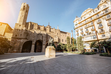 View on the square with Royal palace and statue of Ramon Berenguer during the sunny weather in Barcelona city