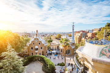 Cityscape view with colorful fairy buildings in the famous Guell park during the morning light in Barcelona