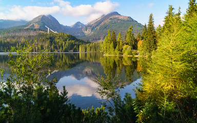 Mountain lake Strbske pleso in National Park High Tatra, Slovakia, Europe. Ski resort in summer and autumn time. Peaceful nature wallpaper. Tranquil vacations travel concept.