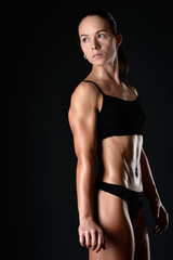 Athletic young woman posing and exercising fitness