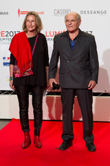 Director Luc Beraud and a guest attend the opening of the Lumiere 2017 Grand Lyon Film Festival in Lyon