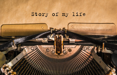 Story of my life typed words on a old Vintage Typewriter. Close-up Wall mural
