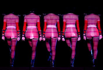 Members of the Crazy Horse Paris cabaret perform an act from their upcoming Forever Crazy performance during a media preview in Singapore