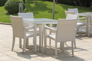 Beauty image of garden furniture outside cafe.