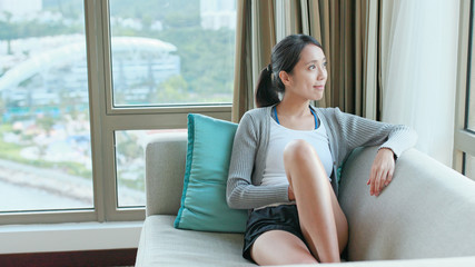 Woman feeling relax and looking out of window