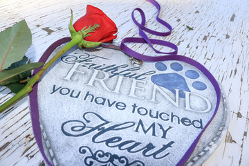 Dog leash surrounding a heart shaped plaque