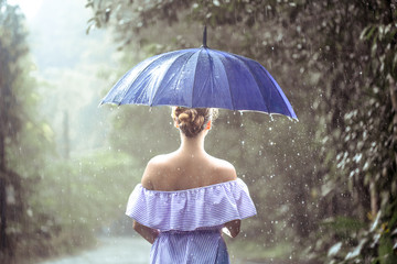 girl with umbrella under the rain