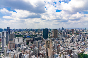 Beautiful city skyline of Downtown Tokyo, Among crowded skyscrapers under blue sunny sky in Tokyo, Japan. Aerial view of busy Tokyo City. 10 October 2017