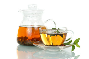 Cup of hot tea with mint and jug isolated on white background