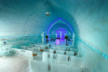 Stunning ice church interior view in Fagaras mountains, Transylvania, Romania