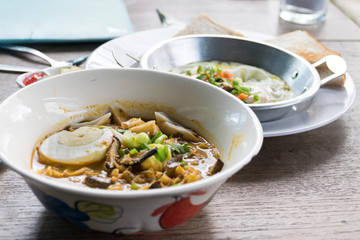 Khao soi or khao soy is a Burmese-influenced dish served widely in northern Laos and northern Thailand