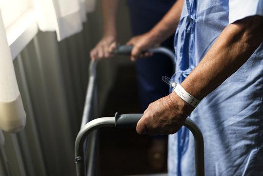 An elderly man using a walker
