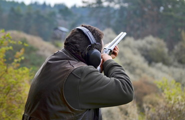 shooter aiming at the asphalt pigeon