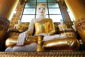 Big buddhism statue in Myanmar style in the Schwedagon pagoda temple