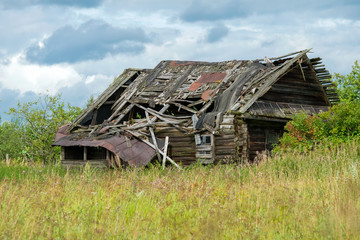 Abandoned and ruined wooden house