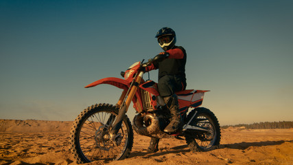 Shot of the Professional Motocross Driver Sitting on His FMX Dirt Bike.