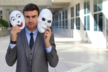 Fishy businessman holding scary masks isolated