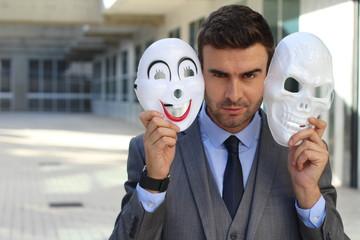 Fishy businessman holding scary masks isolated