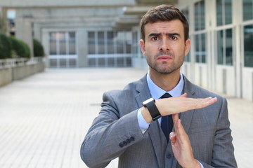 Businessman requesting a break with a hands gesture