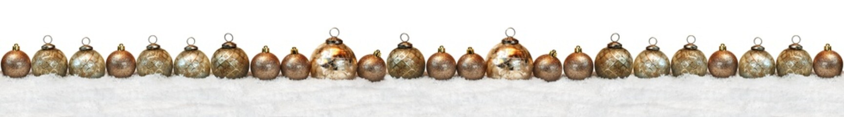Long chain of golden christmas balls in the snow