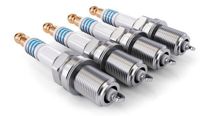 Four spark plugs arranged in a row on a white background