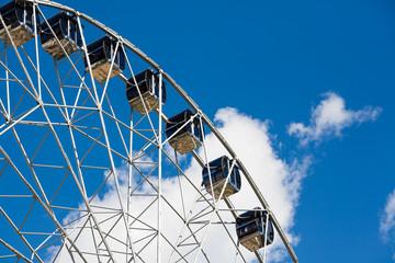 Fototapeta Ferris wheel on blue sky background