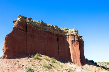 Enormous eroded monolith seen along Texas Hwy 207, known as Hamblen Drive, which runs through red-rock canyon country in the Panhandle