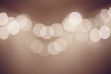 Abstract bokeh background of lights for Happy New Year and Merry Christmas vintage tone