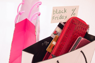 The concept of shopping, shopping paper bags, cards, wallet and tag with the text black Friday