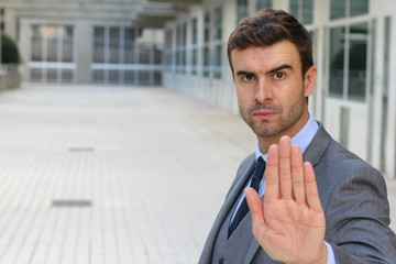 Businessman with a STOP hand gesture