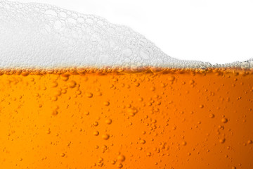 Bubble froth of beer in glass isolate on white background