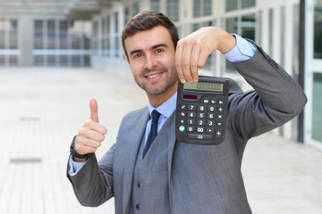 Happy businessman showing a result on his calculator