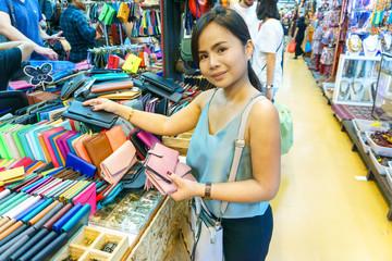 Beautiful asian young woman traveling and shopping at Chatuchak weekend market, Bangkok, Thailand