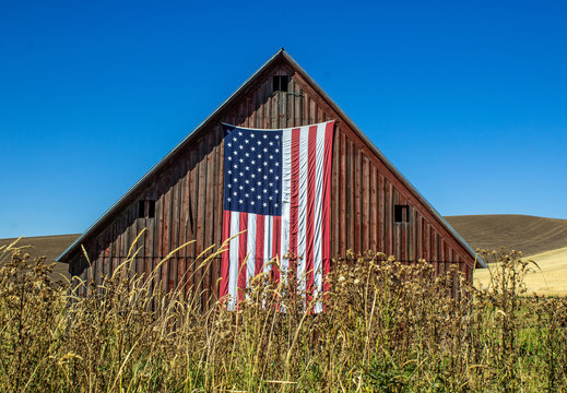 Weathered Red Barn with American Flag