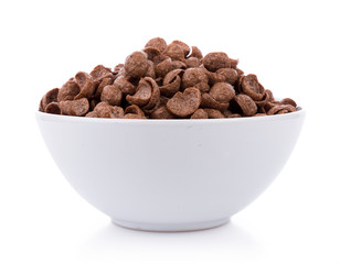 chocolate cereals in white bowl on white background. Cornflakes