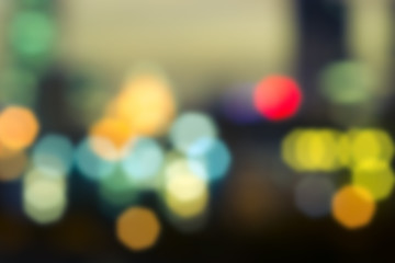 Abstract background of bokeh with toned colors. Defocused city night.