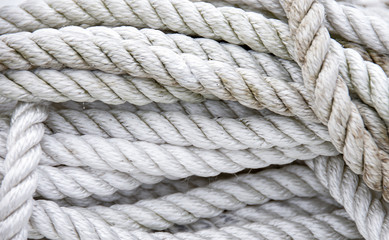 close up of tangled and twisted grungy white nautical rope