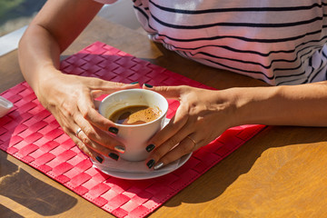 Female hands with coffee Cup