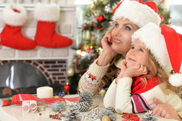 woman and child girl celebrating Christmas