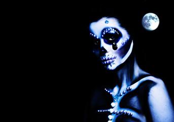 Woman with Halloween Makeup on Dark Background. Halloween Skeleton Make Up