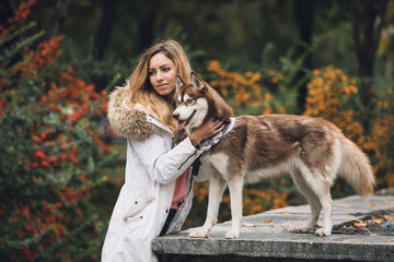 Portrait of woman with her dog husky
