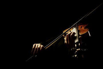 Fotorollo Musik Violin player. Violinist playing violin hands bow