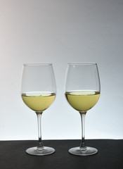 An isolated couple glasses of white wine with white background