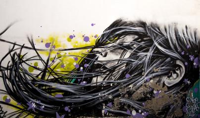 Dreaming woman in street art in Lisbon, Portugal