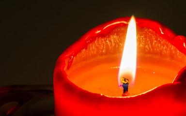 Macro shot of red burning candle