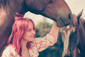Western animal lover woman hugging horse