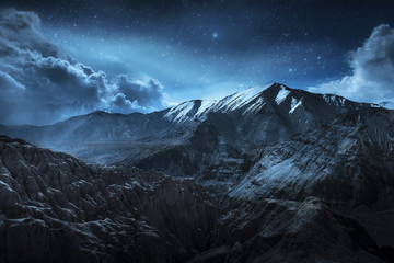 Foto op Plexiglas Bergen Beautiful landscape snow mountains at night on blue cloud and star background. Leh, Ladakh, India.(Double Exposure)