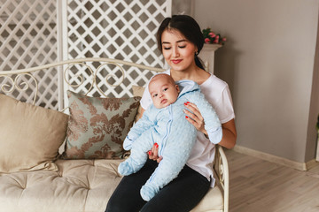 Young asian mother and baby in the room