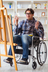 Disabled artist painting picture in studio